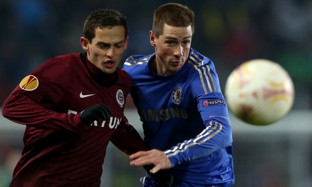 Fernando Torres in action with Mario Holek.