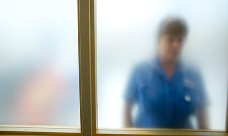 A nurse through frosted glass