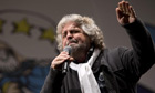 Beppe Grillo addresses supporters at a mass rally in Rome