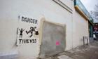 empty wall banksy slave labour