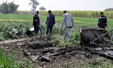 Egyptian police and rescuers inspect the wreckage of a hot air balloon that crashed in Luxor