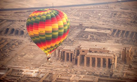 A tourist balloon flies over the temple of Medinet Habu near Luxor, Egypt