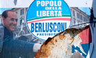 People of Freedom party electoral posters are seen in Rome