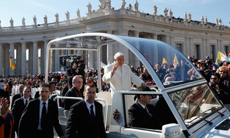 Pope Benedict XVI greets pilgrims in St. Peter's Square at the Vatican