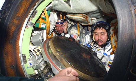 Denis Tito and a Russian cosmonaut in a Soyuz capsule