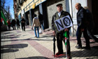 Spanish protester holds 'no cuts' sign