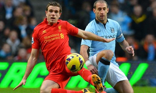 Jordan Henderson and Pablo Zabaleta stretch for the ball.