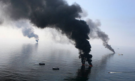Smoke billows from a controlled burn of spilled oil off the Louisiana coast in the Gulf of Mexico