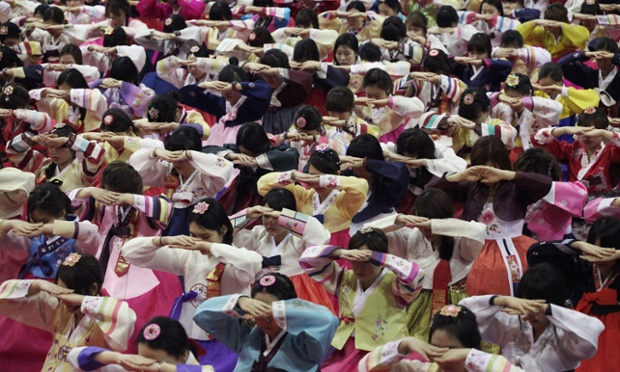 Senior students clad in traditional costumes bow during a joint graduation and coming-of-age ceremony at Dongmyung Girls' high school in Seoul, South Korea. Schools in Korea hold graduation ceremonies in February.