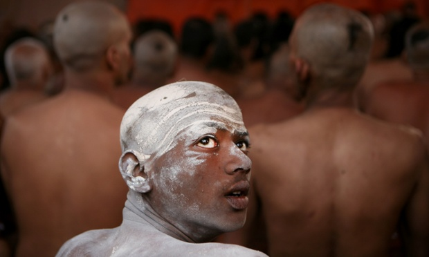 A Naga Sadhu and other Hindu holy men of the Juna Akhara sect participate in a ritual that is believed to rid them of all ties in this life and dedicate themselves to serving God during the Maha Kumbh festival in Allahabad, India.