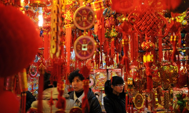 More C.N.Y. news: here customers look at Chinese lanterns at a market in Shanghai ahead of the Lunar New Year.