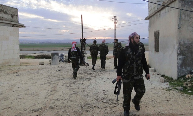 Back to a real war: members of the Free Syrian army walks with his weapon in the town of Nebel near Aleppo.