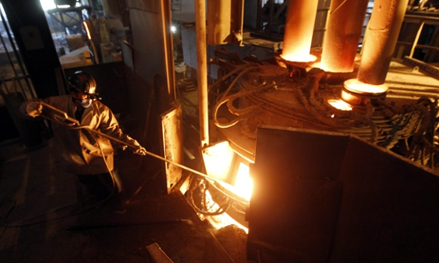 An worker of Krakatau Steel, southeast Asia's biggest steel maker, cooks iron ore in a furnace at the factory in Cilegon, Banten, Indonesia.