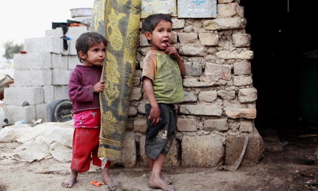 Children stand in front of their house in a compound for displaced people in Baghdad's southeastern Zaafaraniyah district. An estimated 1.55 million people are currently displaced inside Iraq.