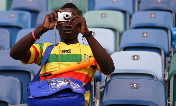 A Mali fan takes pictures before the start of his team's African Cup of Nations semi-final football match against Nigeria, at Moses Mabhida stadium in Durban, South Africa.