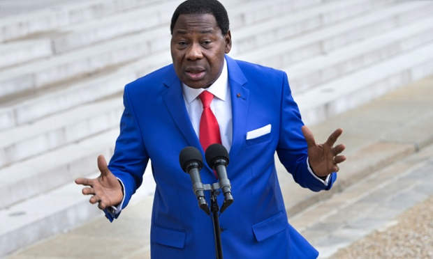 Benin's President Thomas Boni Yayi wears a great suit as he speaks to journalists on leaving a working lunch with France's President at the Elysee presidential palace in Paris.