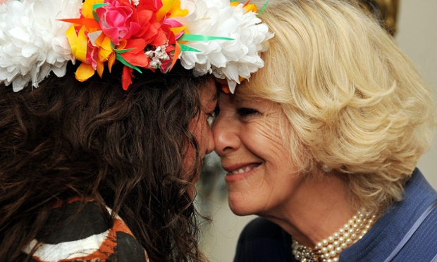 Camilla, Duchess of Cornwall receives a traditional Maori welcome, a hongi, from a New Zealand artist Rosanna Raymond, who is wearing a Tuvalu floral head dress made from silk flowers, during a reception for finalists and past winners of New Zealander and Australian of the year at Clarence House, London today.
