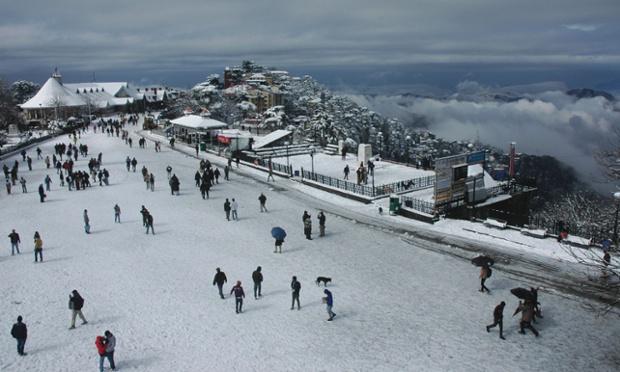 People walking through Shimla after a snowfall in Himachal Pradesh state, India.