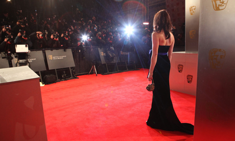 Gemma Arterton arrives at the 2011 Bafta film awards