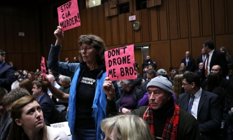 Protesters disrupt the start of the hearing.