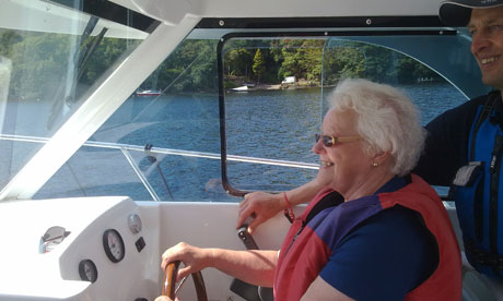 Old lady driving boat