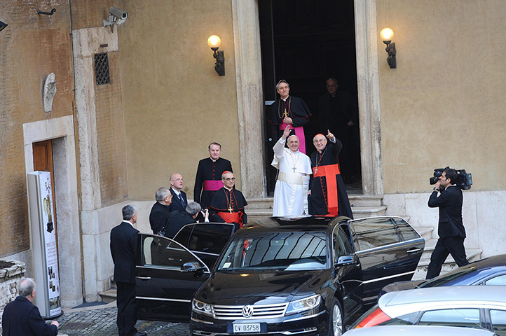 Pope Francis first day: Pope Francis waves as he leaves Santa Maria Maggiore Basilica