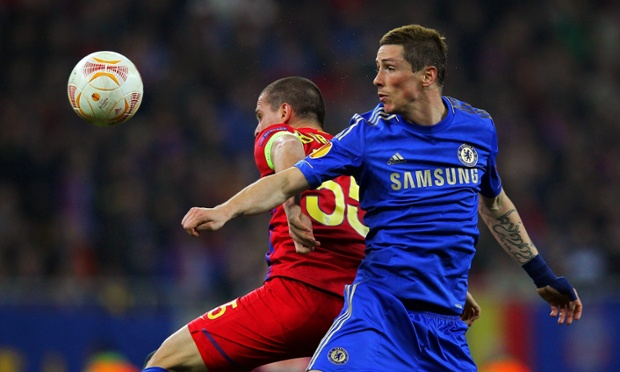Chelsea's Fernando Torres vies for the ball with Steaua's captain Alexandru Bourceanu during the  first leg of their Europa League tie.