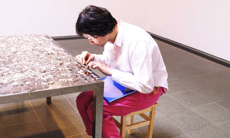 Man solving jigsaw puzzle