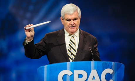 Newt Gingrich, former House speaker, holds a candle as he