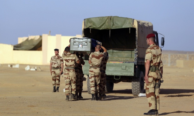 French soldiers carry the coffin of Corporal Alexandre Van Dooren, during a funeral ceremony at the Tessalit camp in northern Mali. Van Dooren was killed on March 16 tracking down jihadist fighters in the northern Malian Ifoghas mountains,