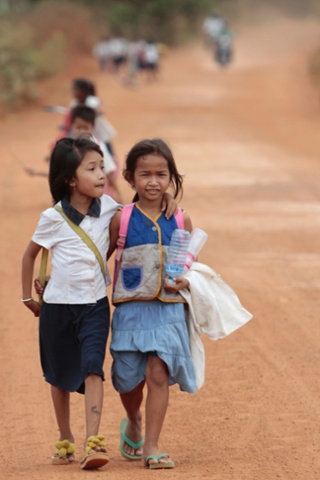 Cambodian school children walk home after a morning school session at Tnoat Kpoh village in the outskirt of Phnom Penh, Cambodia.