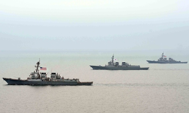Ships of the line: Navy vessels of South Korea and the U.S. participate in a joint military dril, west of Seoul, in this picture released by the South Korean Navy today.
