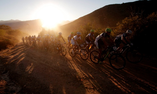 Some of the world's top professional cyclists climb the first major climb on stage 1 of the ABSA Cape Epic Mountain bike race near Citrusdal, South Africa.  The race is considered the Tour de France of mountain biking, 1200 riders take on 698km of racing.