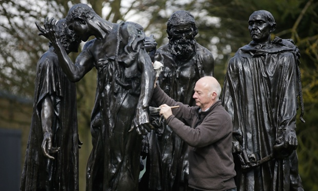 Conservator Rupert Harris waxes Rodin's The Burghers at The Henry Moore Foundation in Perry Green, England. This major exhibition compares the work of English sculptor Henry Moore with one of the pioneers of modern sculpture Auguste Rodin and is the first time any artist has been shown alongside Henry Moore on his estate.