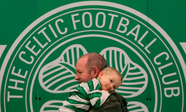 Fans including Fiachna McGuire, 3, on his dad Paddy's shoulder waiting in the queue to meet Celtic Manager Neil Lennon in the Celtic Store, in the Jervis Shopping Centre, Dublin where he met fans and signed copies of his new book.