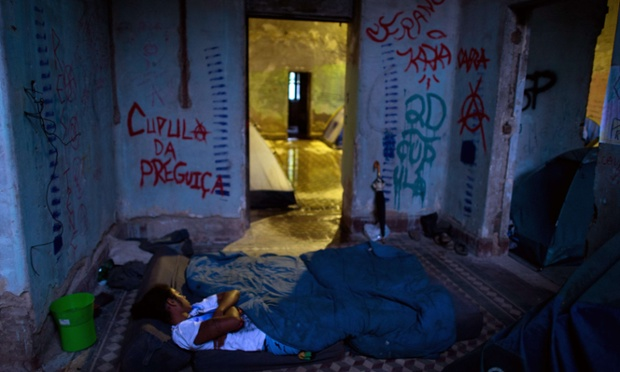 An activist sleeps inside the former Indigenous Museum, the Aldea Maracana, next to the Maracana stadium in Rio de Janeiro. Indigenous people have been occupying the place since 2006, which is due to be pulled down to construct 10,500 parking lots for the upcoming Brazil 2014 FIFA World Cup.