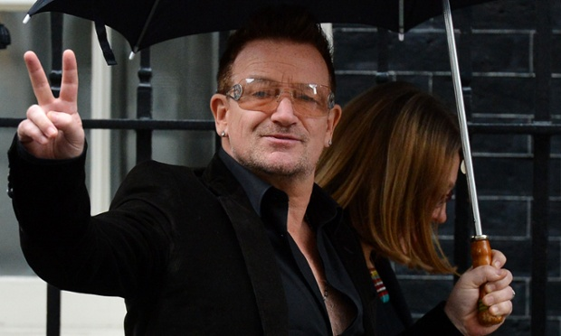 Irish musician Bono arrives at 10 Downing street in London and does a rock-star v-sign for the photographers as usual.