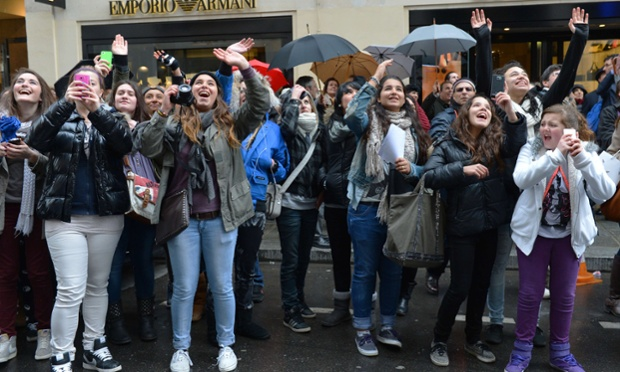 Fans of Canadian singer Justin Bieber gather outside his hotel in Paris, on the eve of his concert for the I Believe tour at the Palais Omnisport de Paris-Bercy.