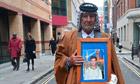 Mizal Karim al-Sweady holds a photograph of his dead son Hamid Al-Sweady