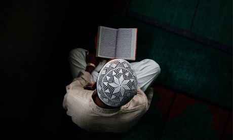 Boy reading the Qur'an