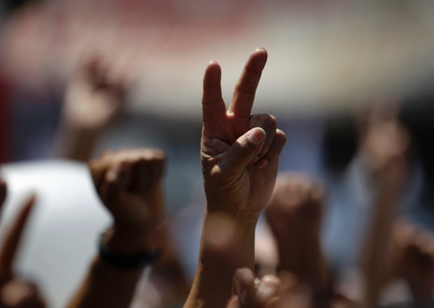 Supporters of the National Movement of Regeneration (MORENA) raise their hands during a protest against the new proposed energy reforms in Mexico City. Thousands of leftist members of MORENA protested against government plans to overhaul Mexico's energy sector, a preview of the tough road ahead for President Enrique Pena Nieto's reform push.