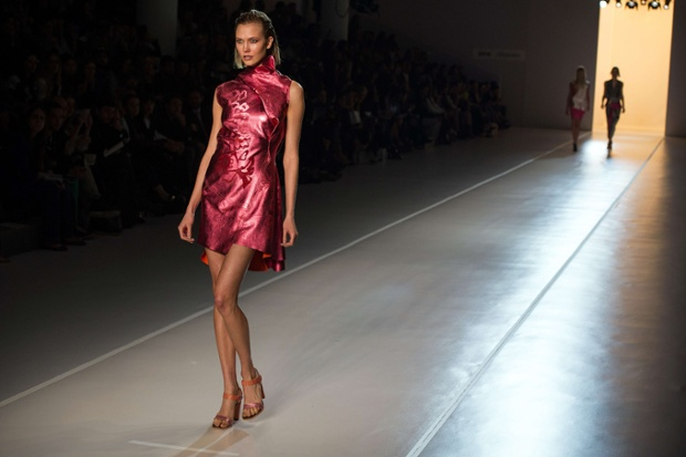 American super model Karlie Kloss presents a creation by Animale during the 2013 Summer collections of the Sao Paulo Fashion Week in Sao Paulo, Brazil.
