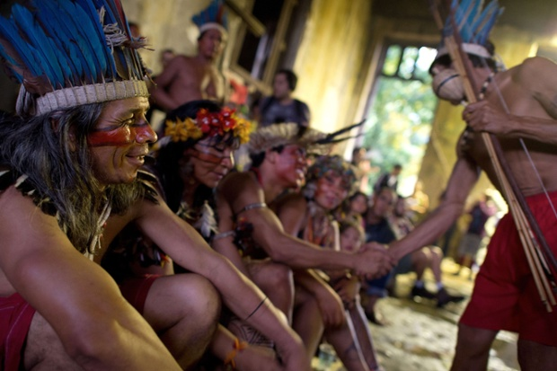 People observe as two indigenous couples celebrate their weddings inside the former Indigenous Museum in Rio de Janeiro, Brazil. Indigenous people have been occupying the place since 2006, which is due to be pulled down to construct a parking lot for the upcoming Brazil 2014 FIFA World Cup.