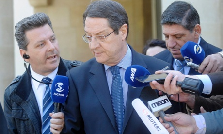 Cypriot President Nicos Anastasiades talks with media representatives as he leaves the presidential palace after a cabinet meeting in Nicosia, Cyprus, 18 March 2013.