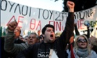 Protesters chant slogans outside the Cypriot parliament against a crucial parliamentary vote on a plan to seize a part of depositors' bank savings, in central Nicosia, Tuesday, March 19, 2013.
