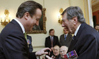 David Cameron presents a Bomber Command clasp to retired Air Commodore Charles Clarke