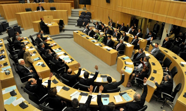 Cyprus's parliament overwhelmingly rejected a proposed levy on bank deposits, throwing a eurozone bailout into disarray.  Photograph: Reuters/Yiannis Nissiotis