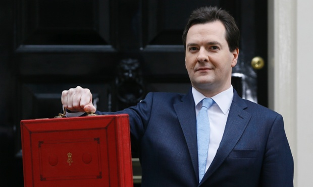 George Osborne poses for the media before the 2013 budget on 20 March 2013.