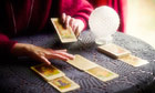 Tarot cards are laid out in a scene from Punchdrunk's The Drowned Man: A Hollywood Fable