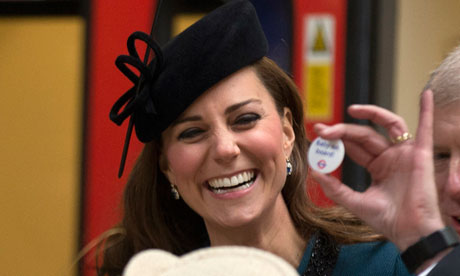 The Duchess of Cambridge is presented with a 'Baby on board' badge